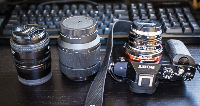 Kit zoom and tiny Nikkor 50mm 1.4D with adapter are too big... M-mount adapter and Voigtlander lens are much smaller and more useful.